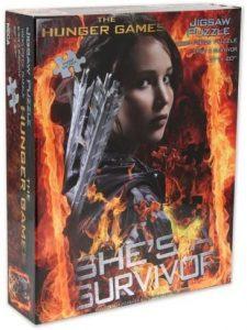 Los mejores puzzles de los Juegos del Hambre - Puzzle de los Juegos del Hambre She is a Survivor de 1000 piezas de NECA
